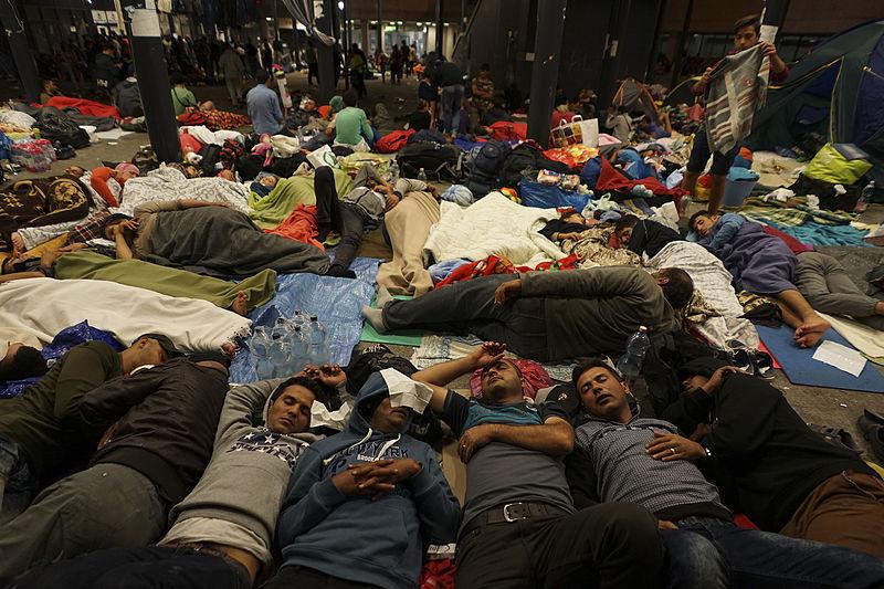 Syrian_refugees_having_rest_at_the_floor_of_Keleti_railway_station._Refugee_crisis._Budapest,_Hungary,_Central_Europe,_5_September_2015